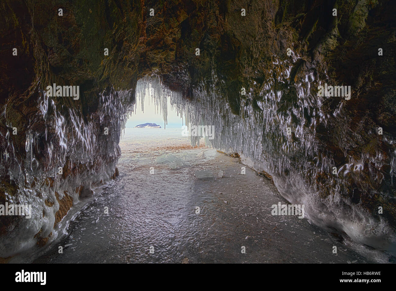 Curtain of icicles from the cave. - Stock Image