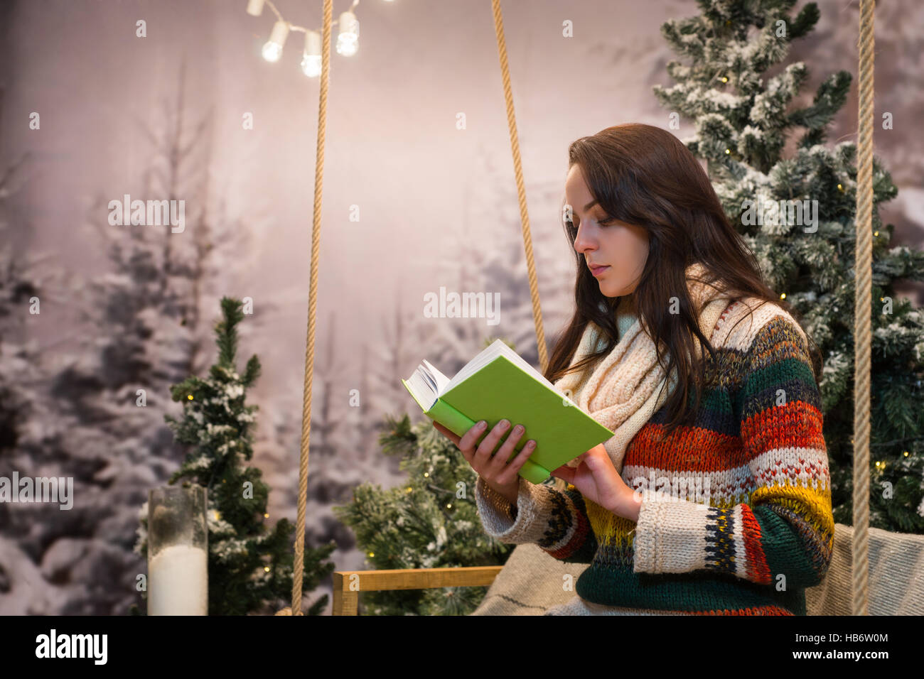Girl reading under tree stock photos girl reading under tree stock romantic young woman reading a book while sitting on a swing with a blanket under the sciox Gallery