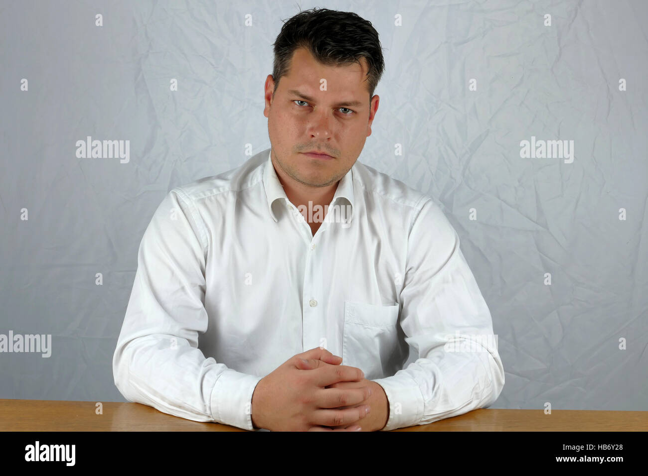 Young angry business man watching - Stock Image