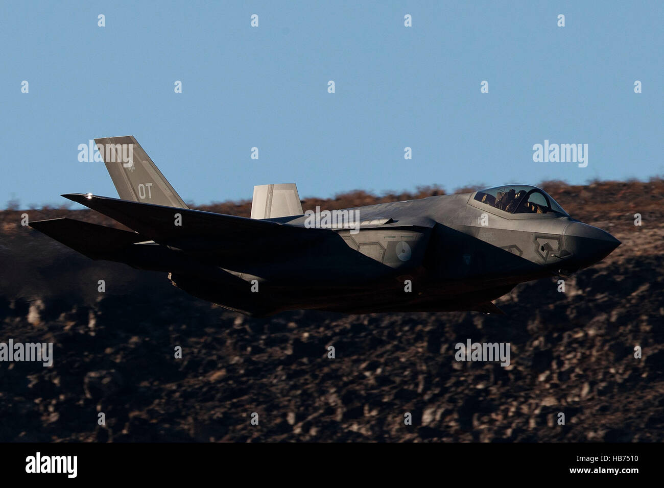 Lockheed Martin F-35A Lighting II from the 323 Squadron, Royal Netherlands Air Force, flies low level through the - Stock Image