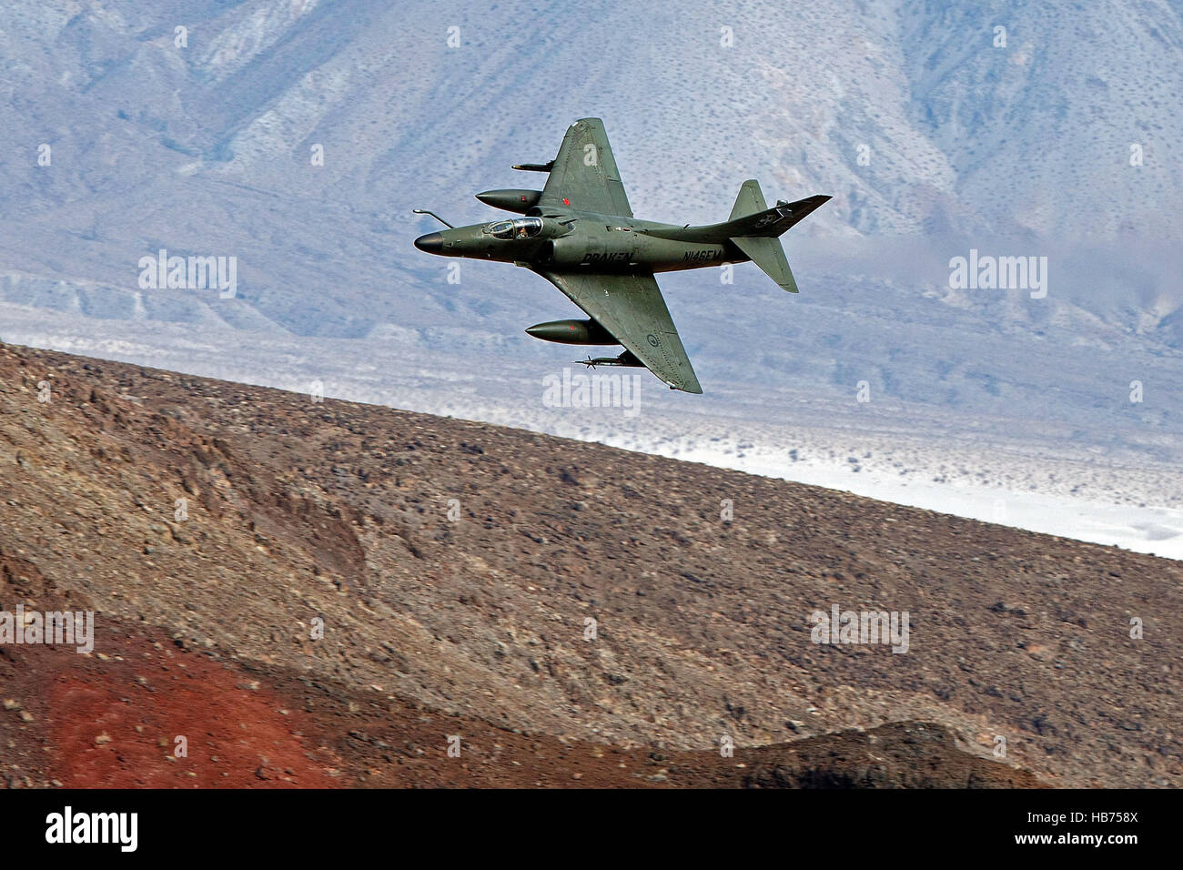 A Draken operated Douglas A-4K Skyhawk, flies low level through the Jedi Transition, Star Wars Canyon, Death Valley - Stock Image