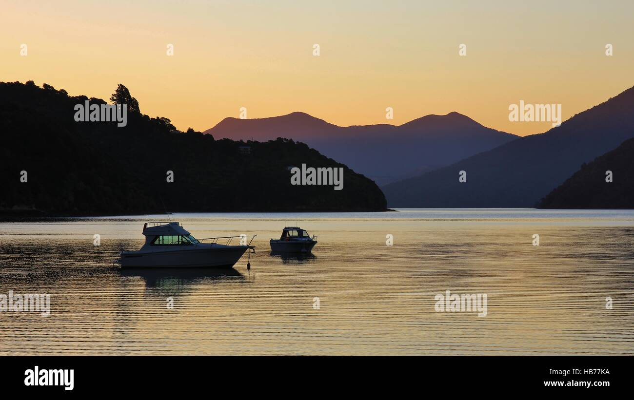 Boats at sunset in Portage Bay - Stock Image