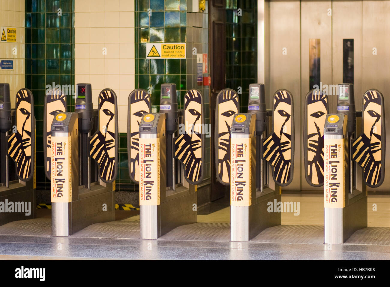 Ticket Barriers at London Underground advertising The Musical, The Lion King - Stock Image