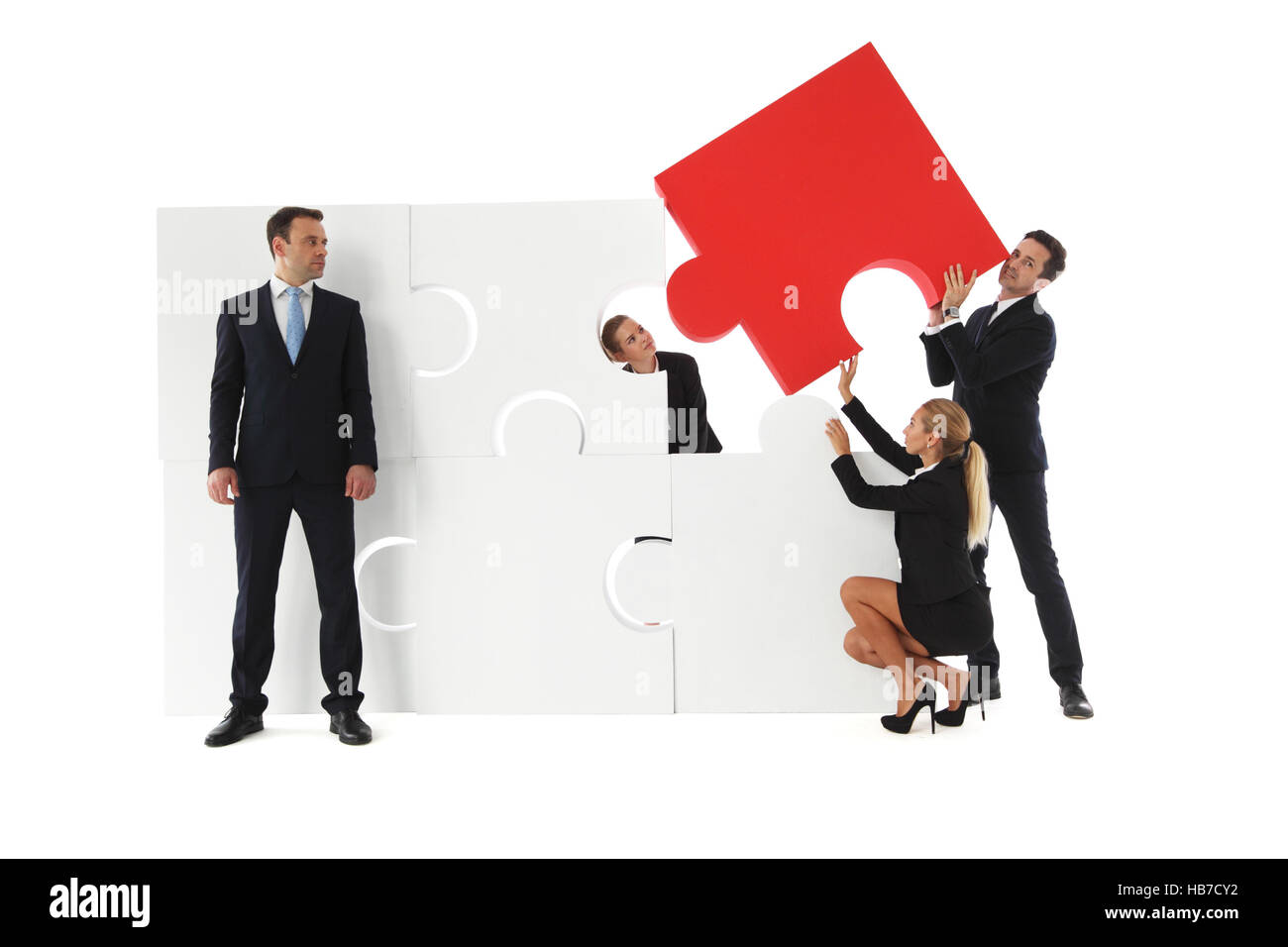 business teamwork building big puzzle stock photos