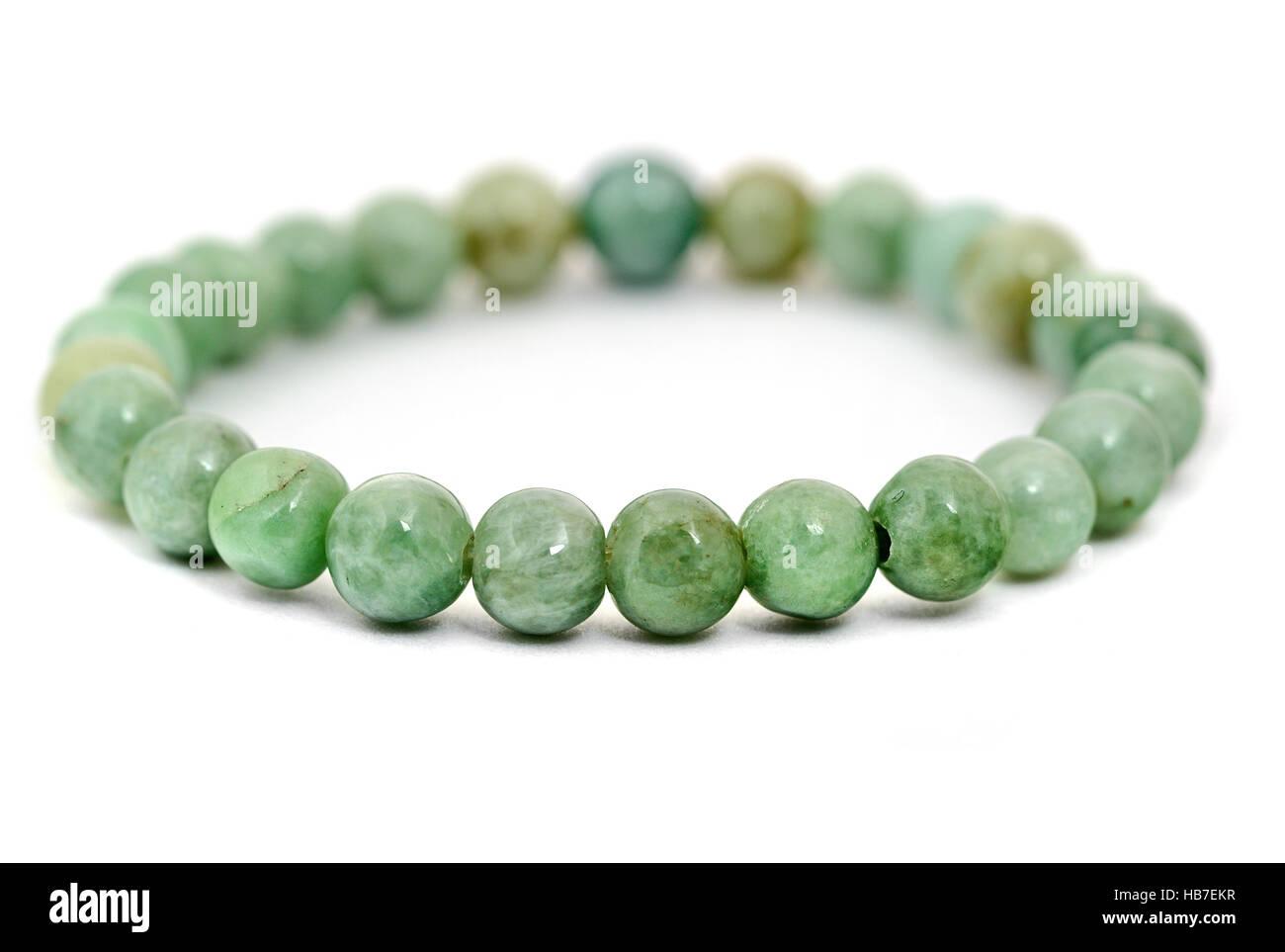 Jade bracelet isolated on white - Stock Image