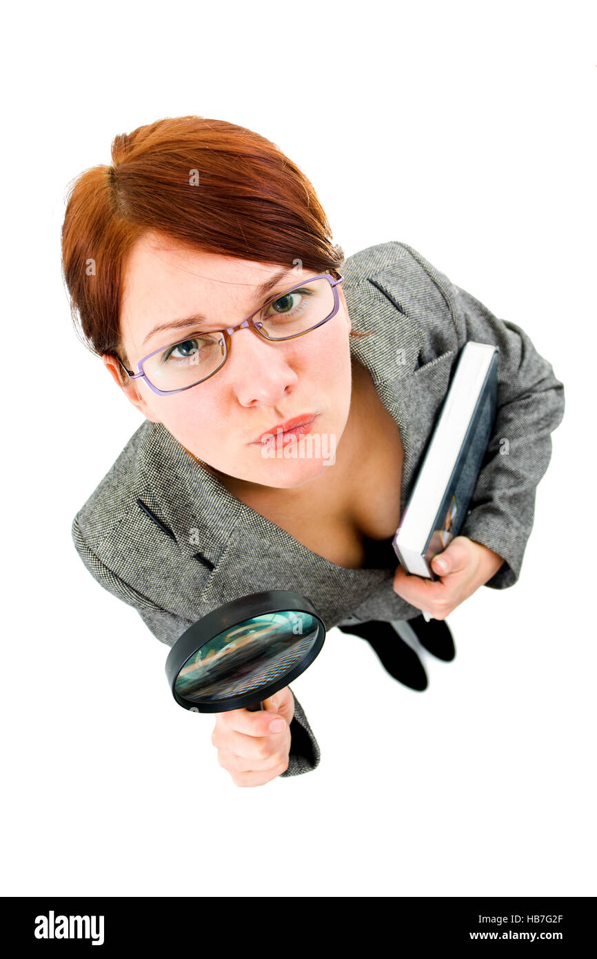 woman looking into a magnifier - Stock Image