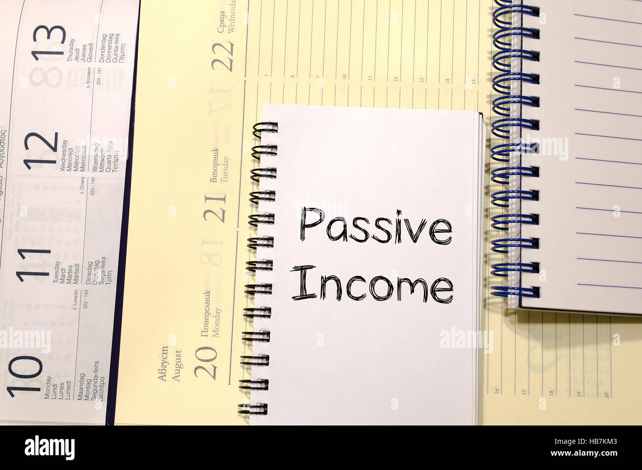 Passive income write on notebook - Stock Image