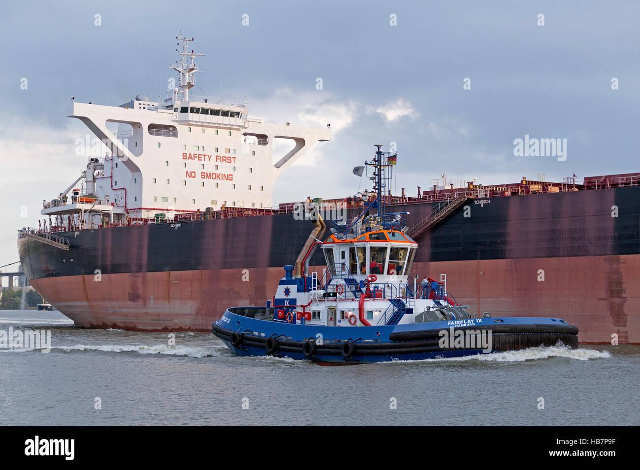 cargo ship and towboat harbour, Hamburg, Germany - Stock Image