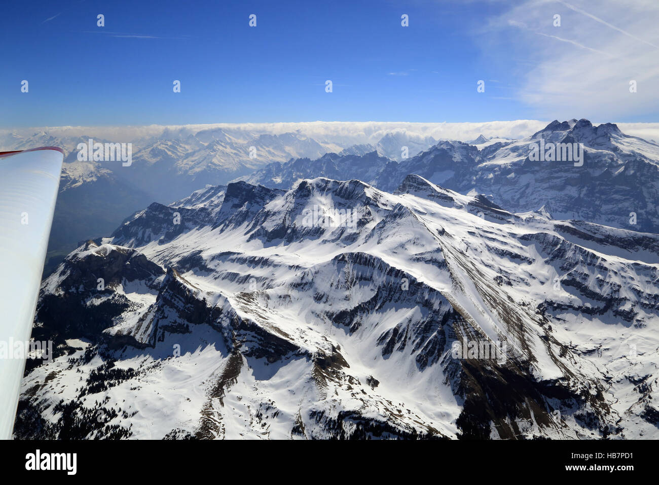 Motorglider in the Swiss Alps over Axalp Stock Photo