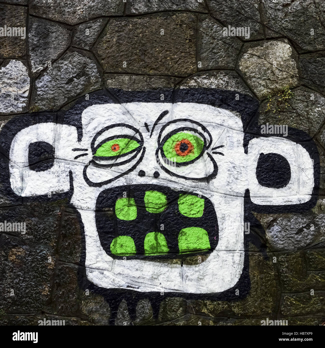 Grimace of a monster on the wall - Stock Image