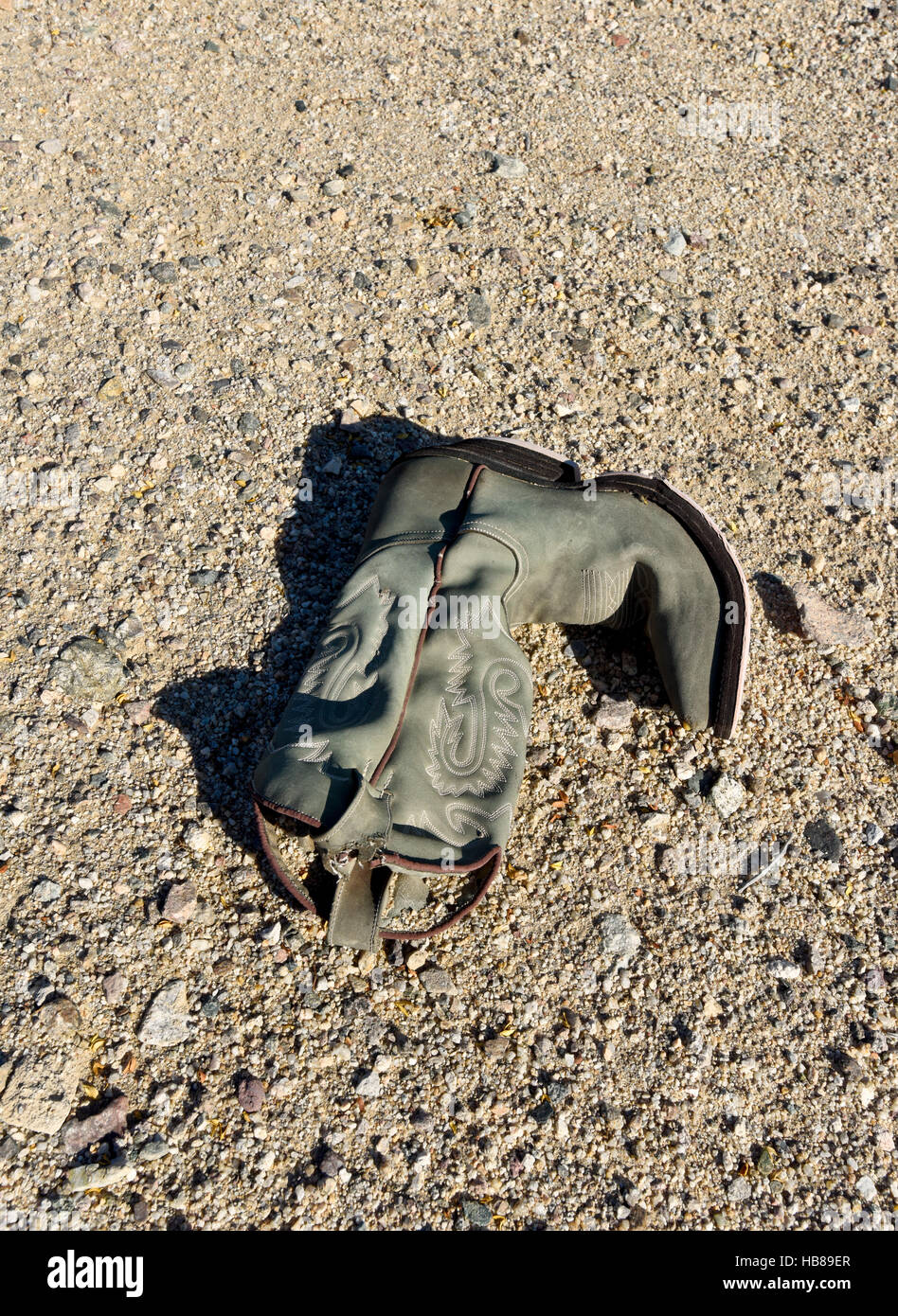 An old weathered boot in the middle of the California Mojave Desert Stock Photo