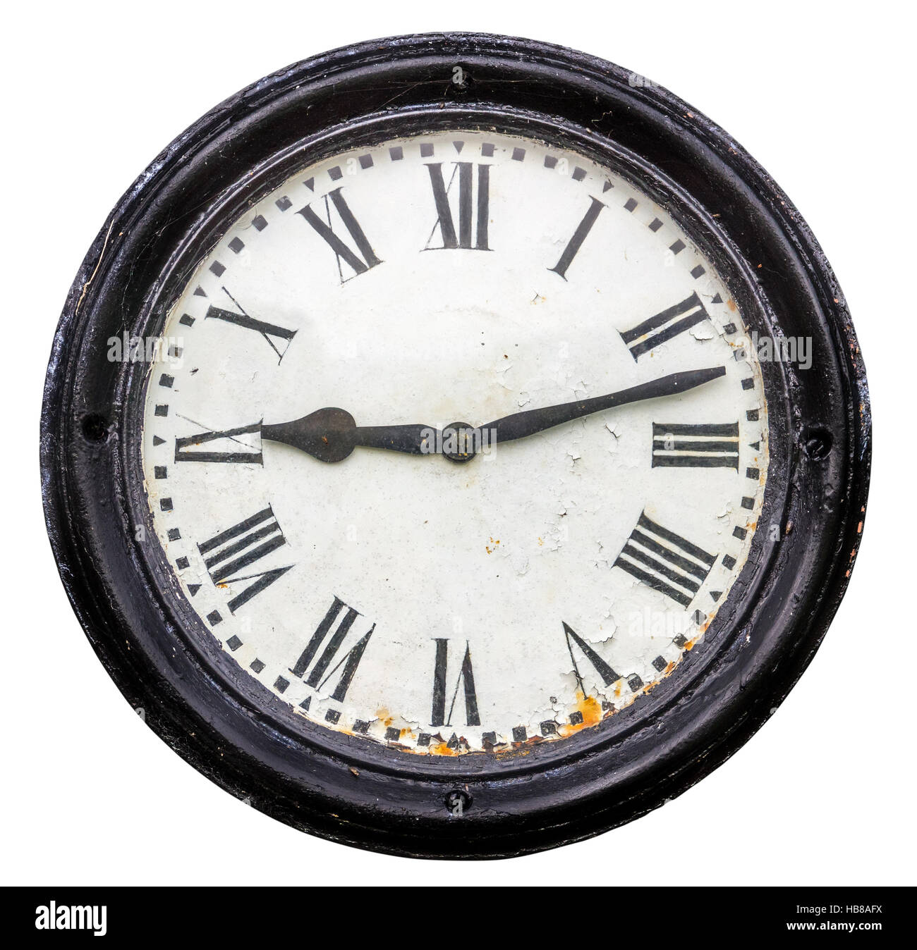 Rustic Old Roman Numeral Station Clock Face - Stock Image