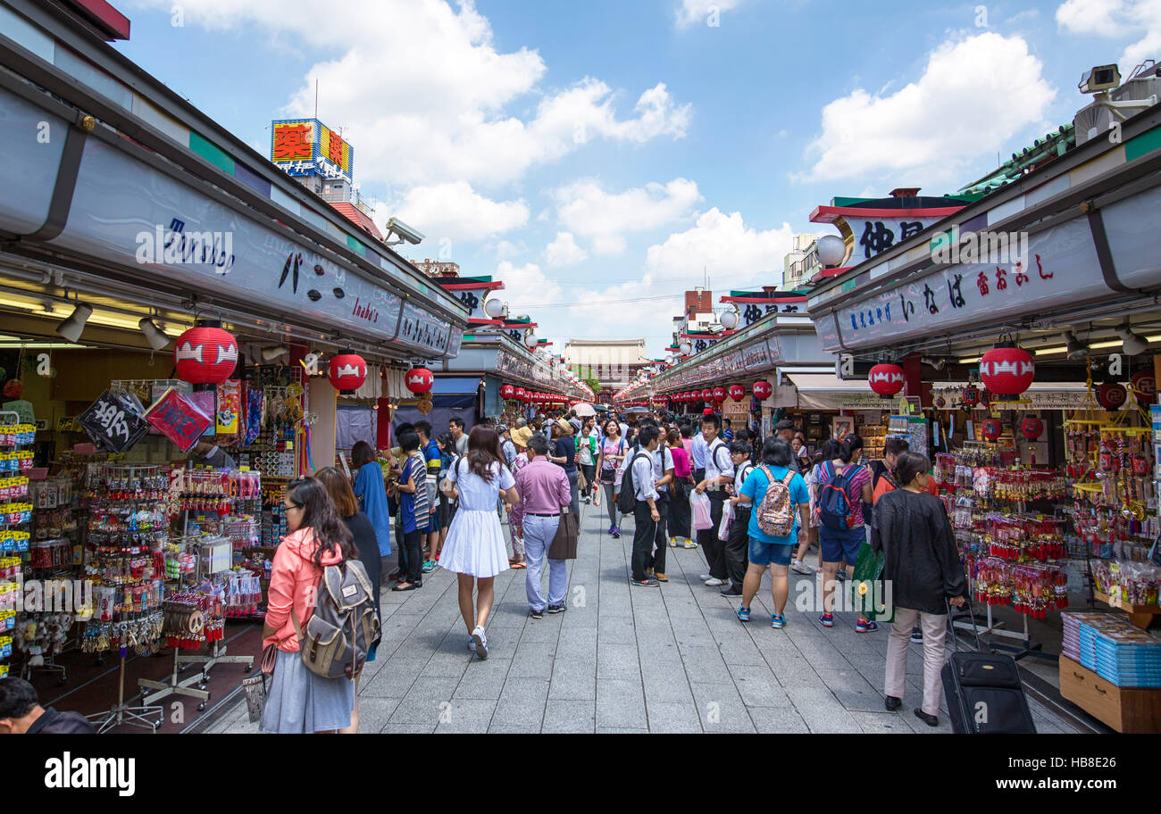 TOKYO, JAPAN - 10 JUNE 2016 :Tourists walk on Nakamise Dori in Sensoji shrine. Traditional, local snacks and tourist - Stock Image