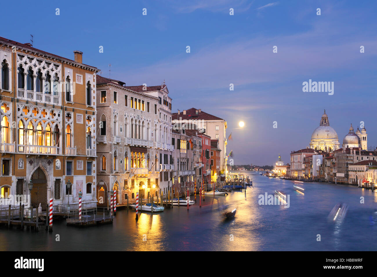 Palazzo Franchetti on Grand Canal, Venice, Italy, at dusk, with full moon. View from Academia bridge. - Stock Image