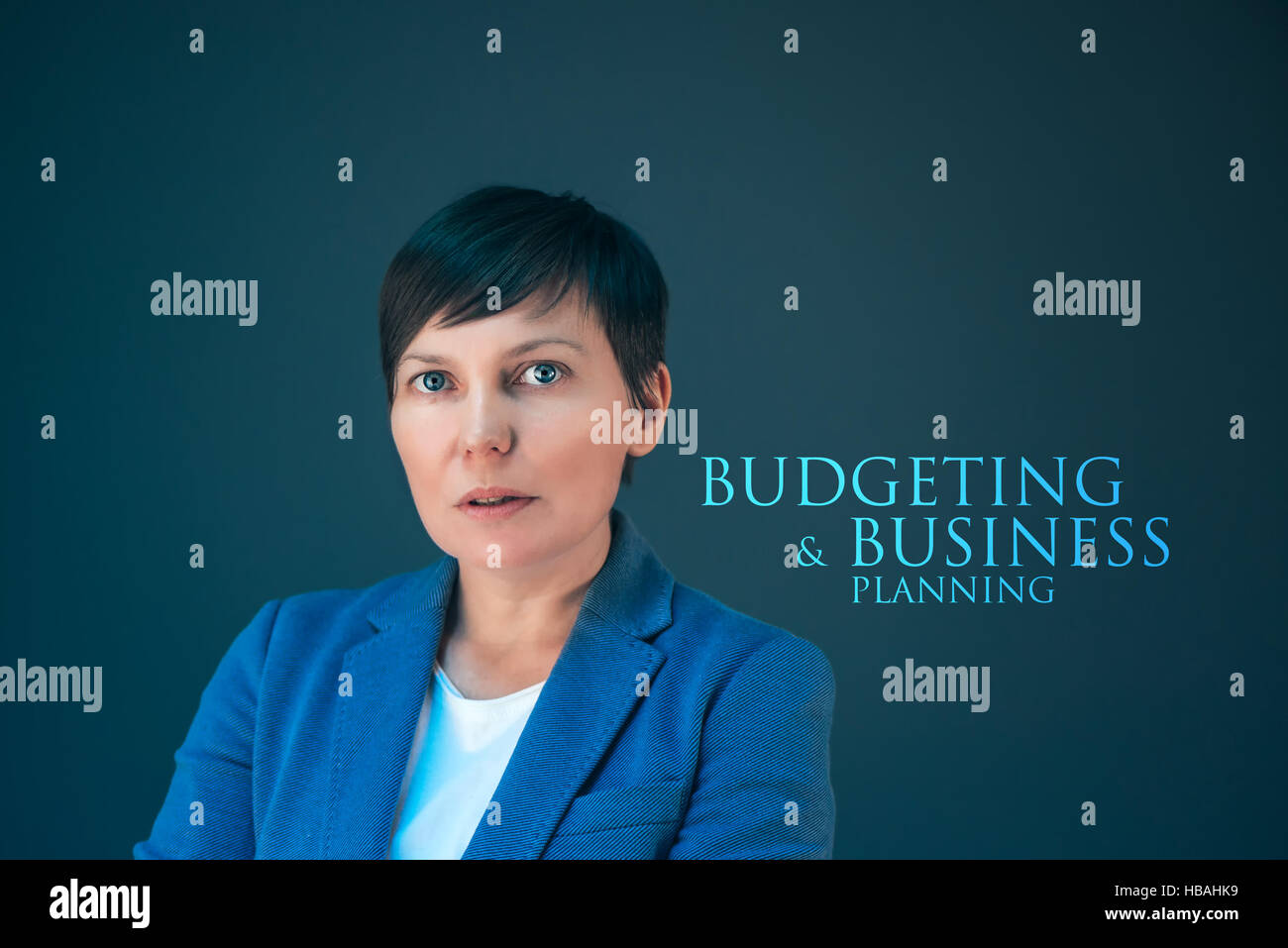Budgeting and business planning with young adult caucasian businesswoman - Stock Image