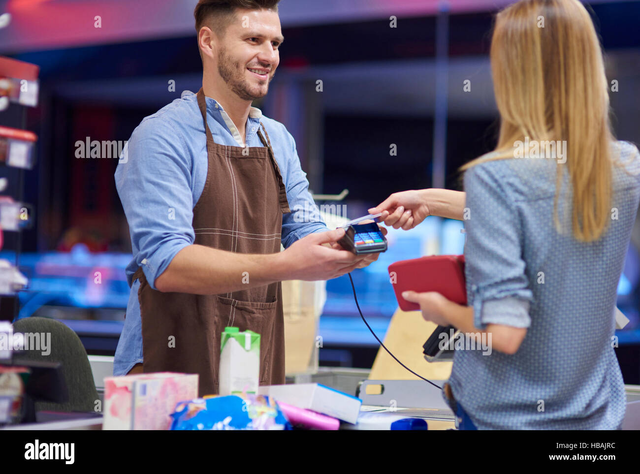 Contactless payment done by woman - Stock Image
