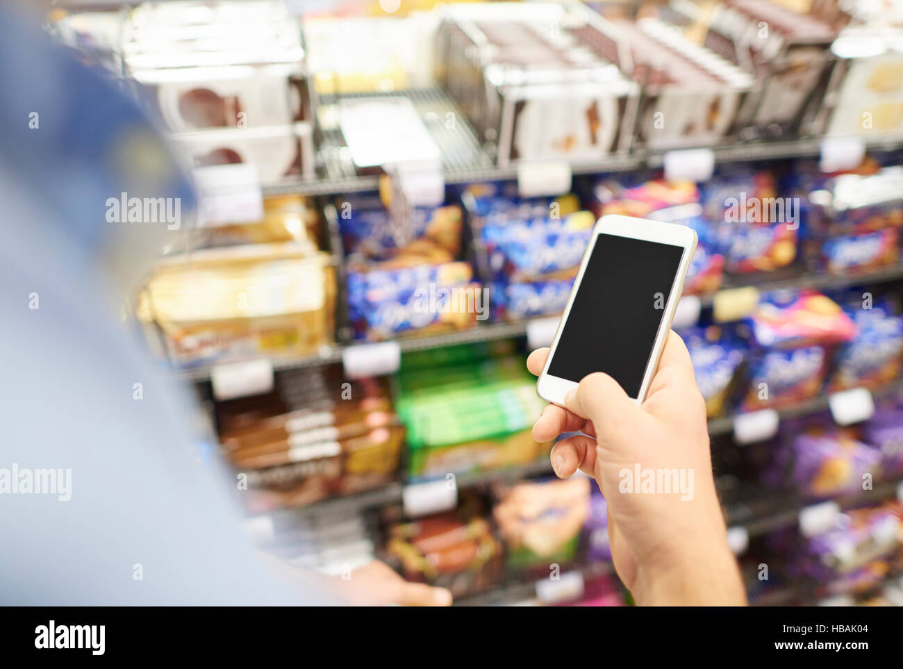 The unrecognizable person using phone - Stock Image