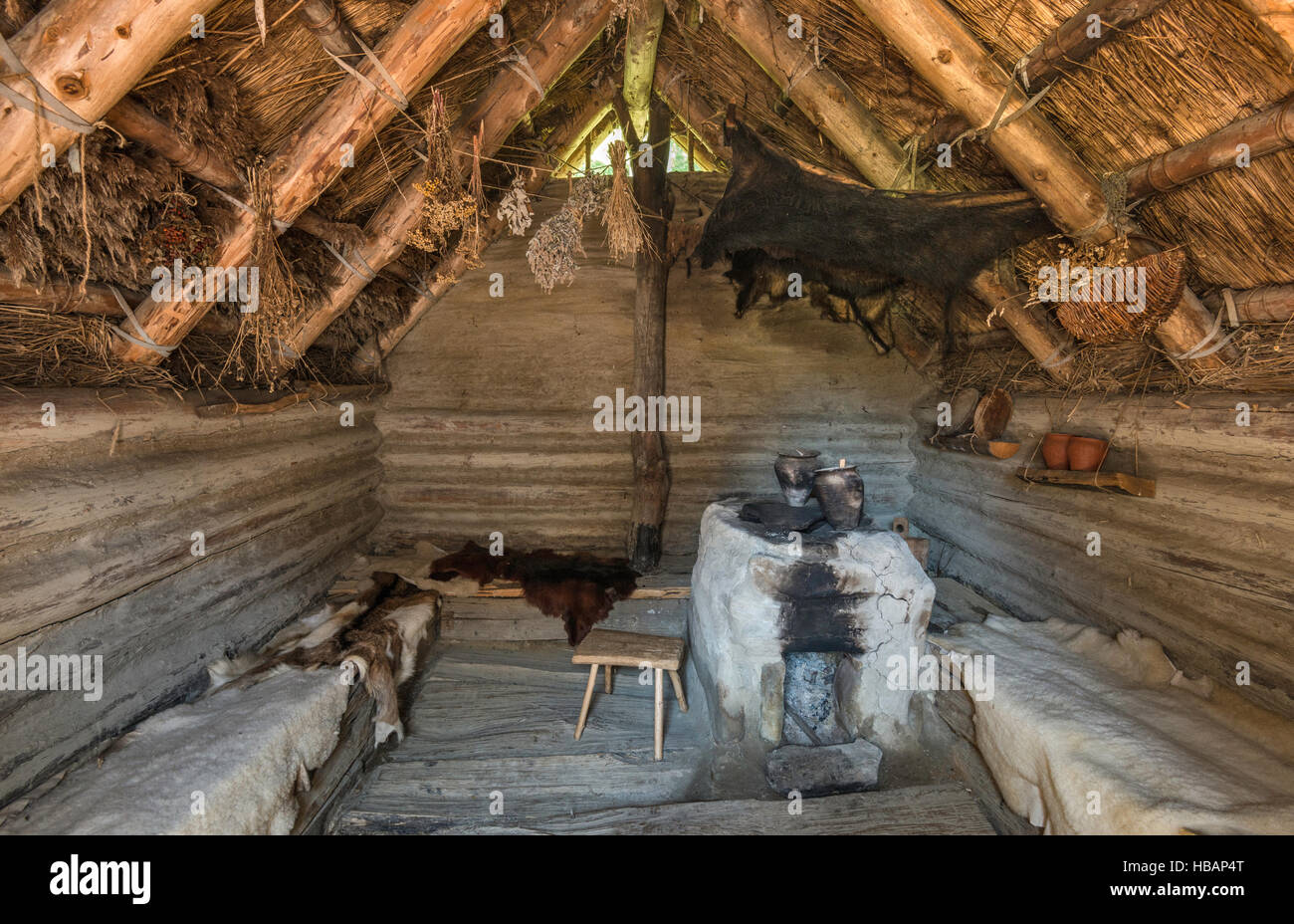 Interior of Slavonic cottage, 9th century, reconstruction, Carpathian Troy Archaeological Open-Air Museum in Trzcinica, - Stock Image