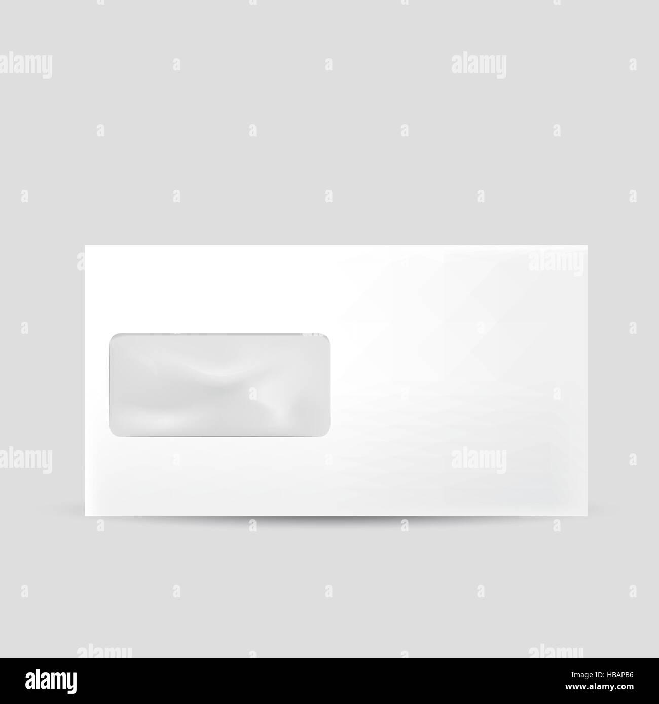 blank envelope with window isolated on grey background - Stock Image