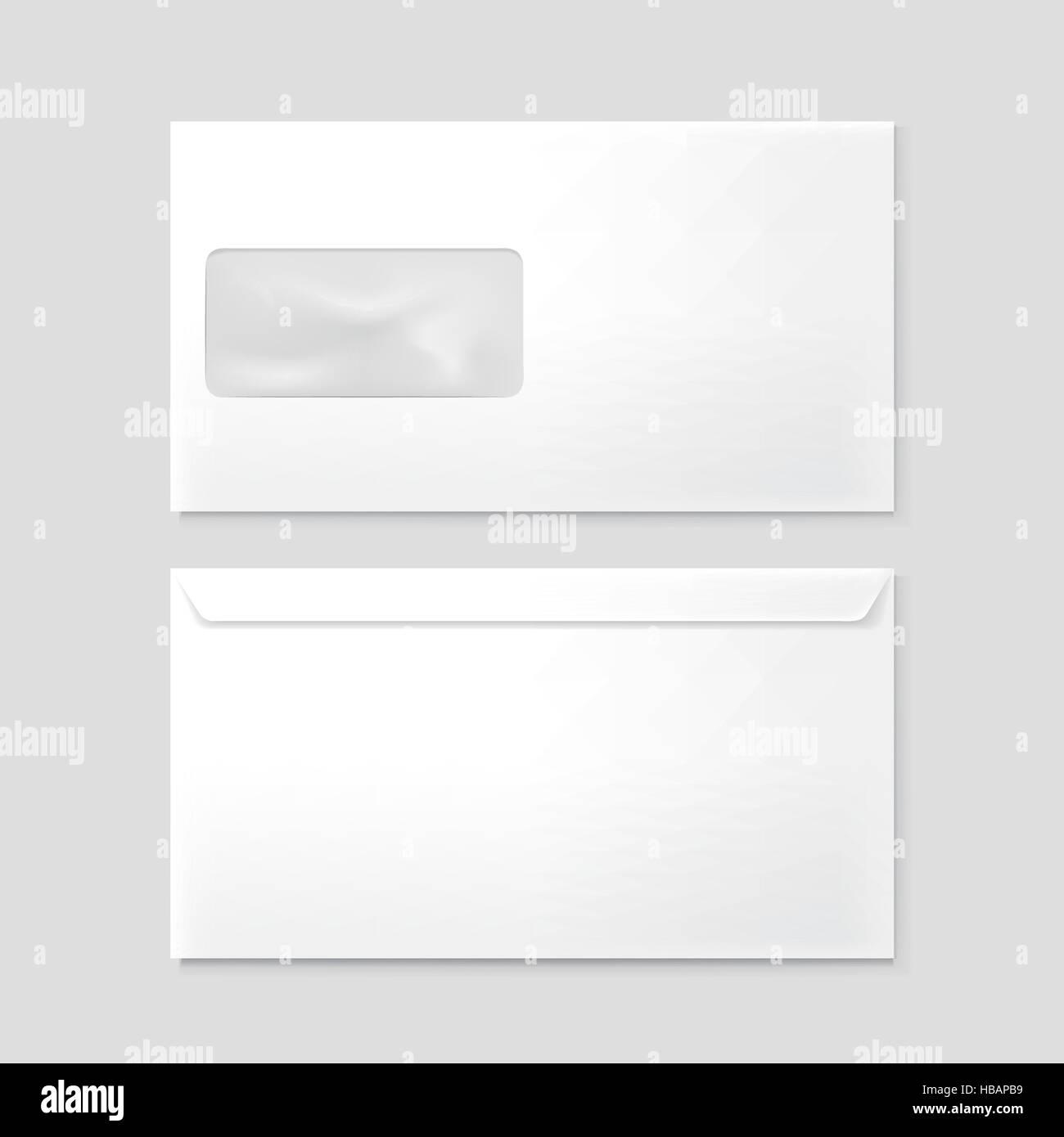 blank envelopes with window isolated on grey background - Stock Image