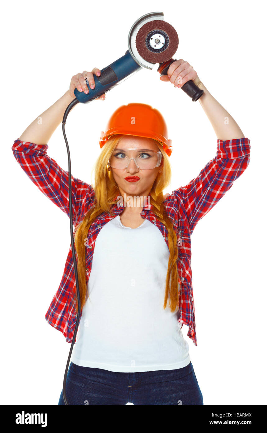 Funny female construction worker in a hard hat with angle grinder over white background - Stock Image