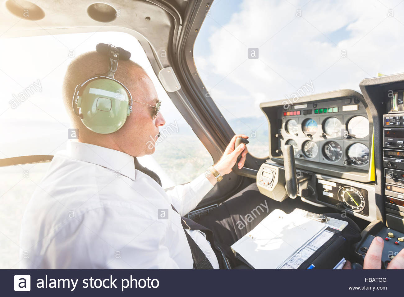 Pilot in cockpit of aircraft, in flight - Stock Image