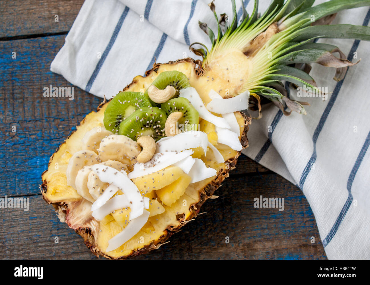 cut in half pineapple with coconut chia kiwi cashew perfect for