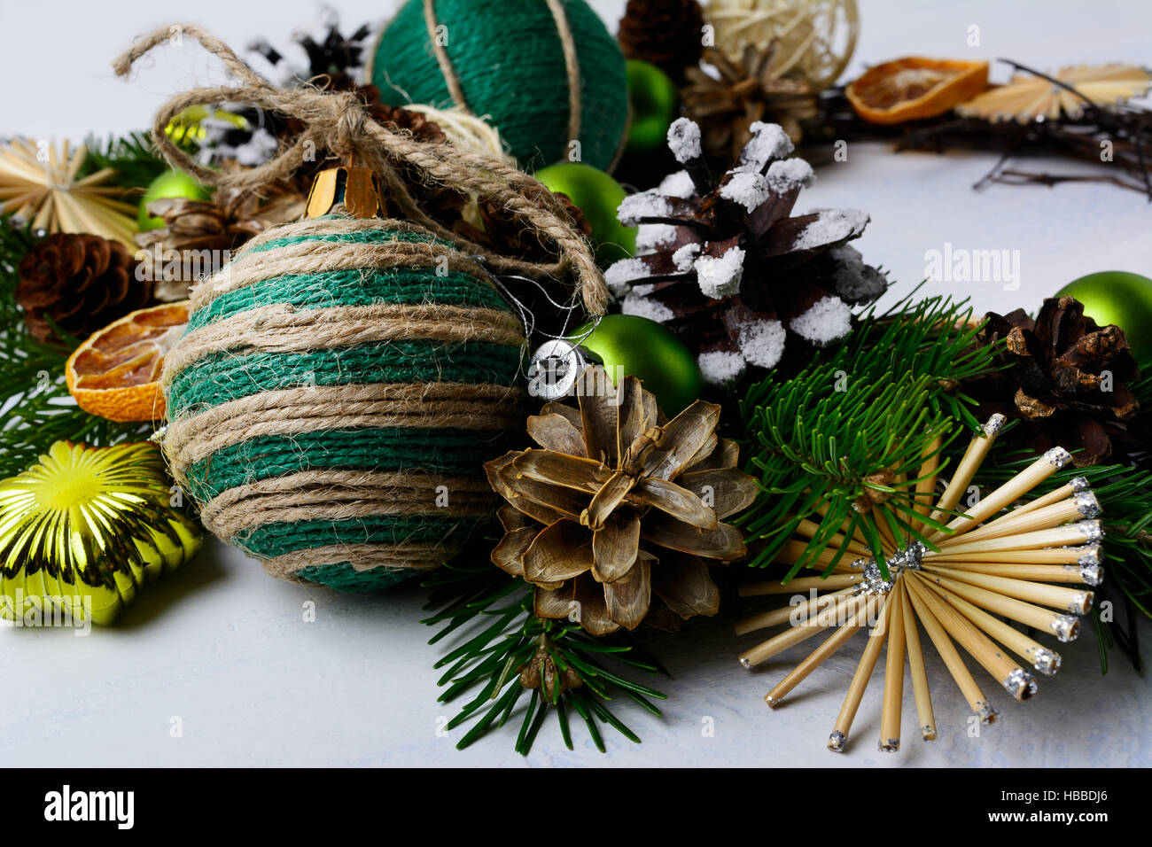 Christmas Decoration With Snowy Pine Cones And Rustic Bauble Background Fir Branches Homemade Twine Straw Ornaments