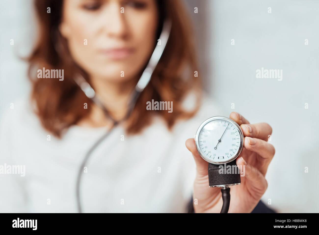 Selective focus of tonometer for measuring pressure - Stock Image