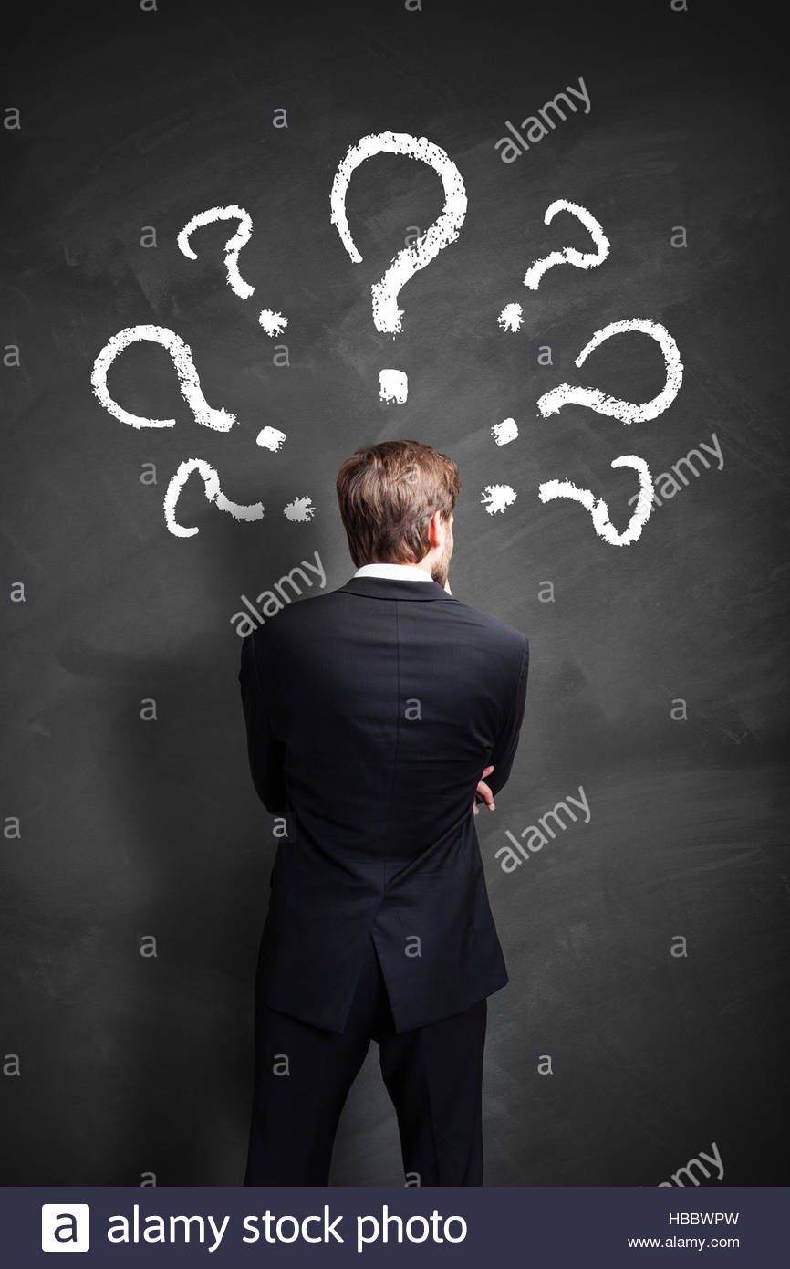 businessman with many questions - Stock Image