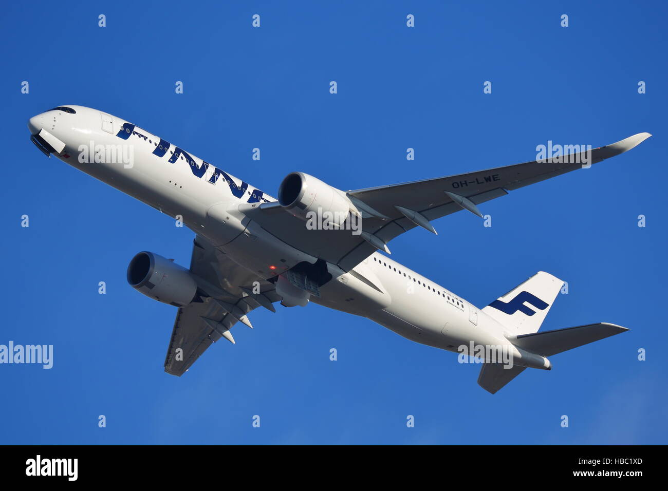 Finnair Airbus A350-900 OH-LWE departing from London Heathrow Airport, UK - Stock Image
