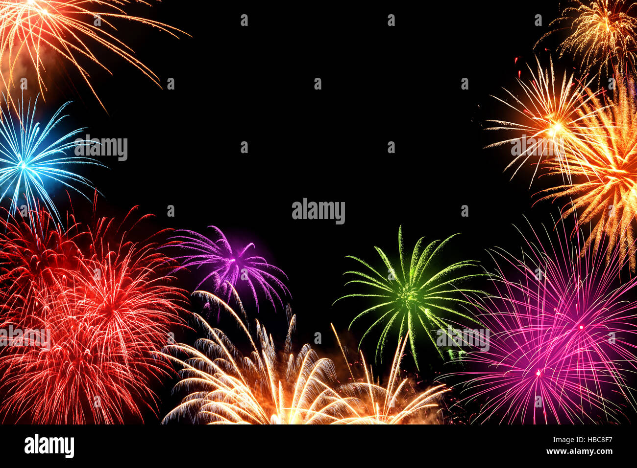 gorgeous multi colored fireworks as a border on black background ideal for new year or other celebration events