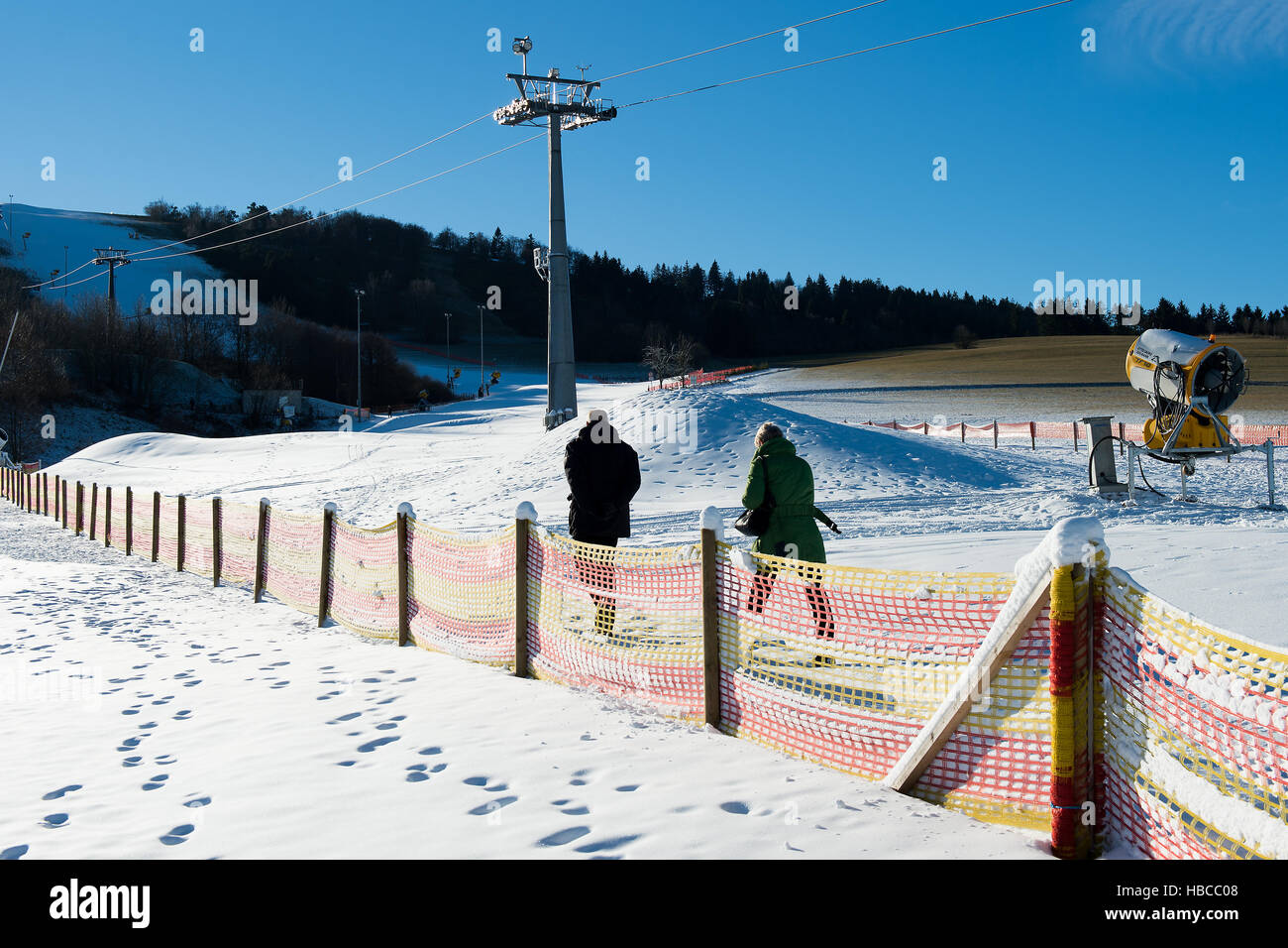 willingen, germany. 5th dec, 2016. hikers walk past ski slopes and a