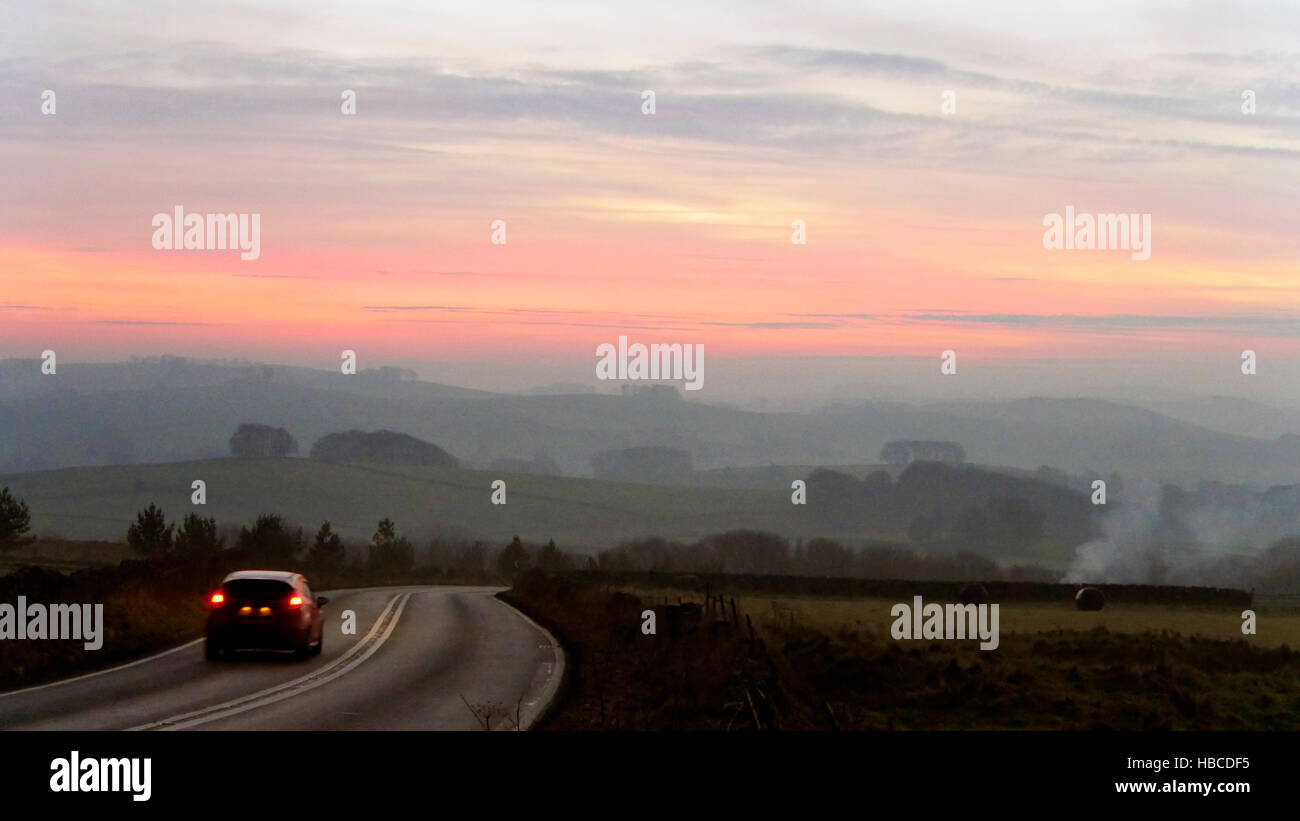 Derbyshire, UK. 5th Dec, 2016. UK Weather: amazing red sunset on a cold misty foggy evening from the A515 betweenStock Photo
