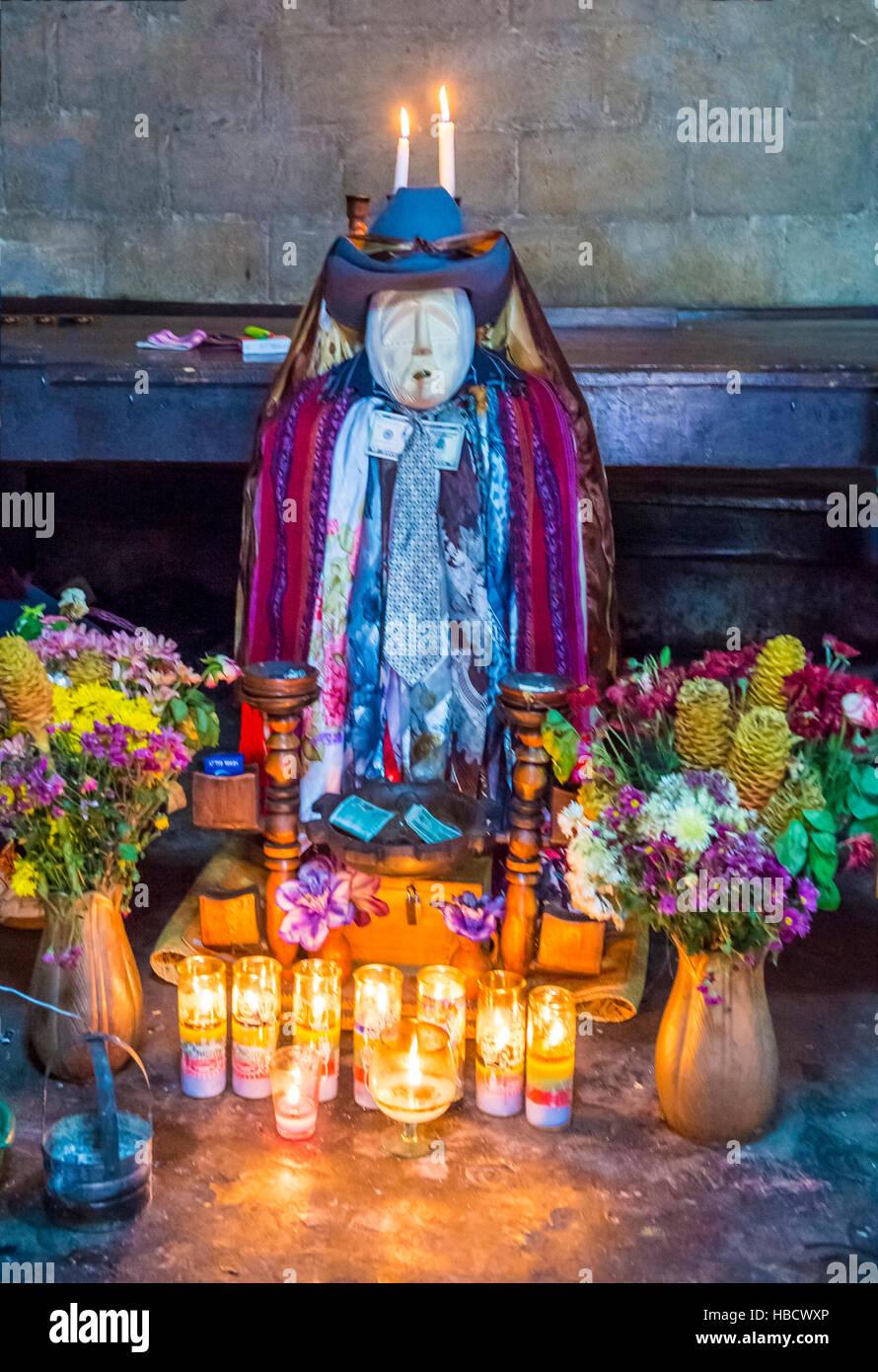 Shrine of El Maximon in Santiago De Atitlan , Guatemala. Maximon saint/devil is one of the strongest remnants of - Stock Image