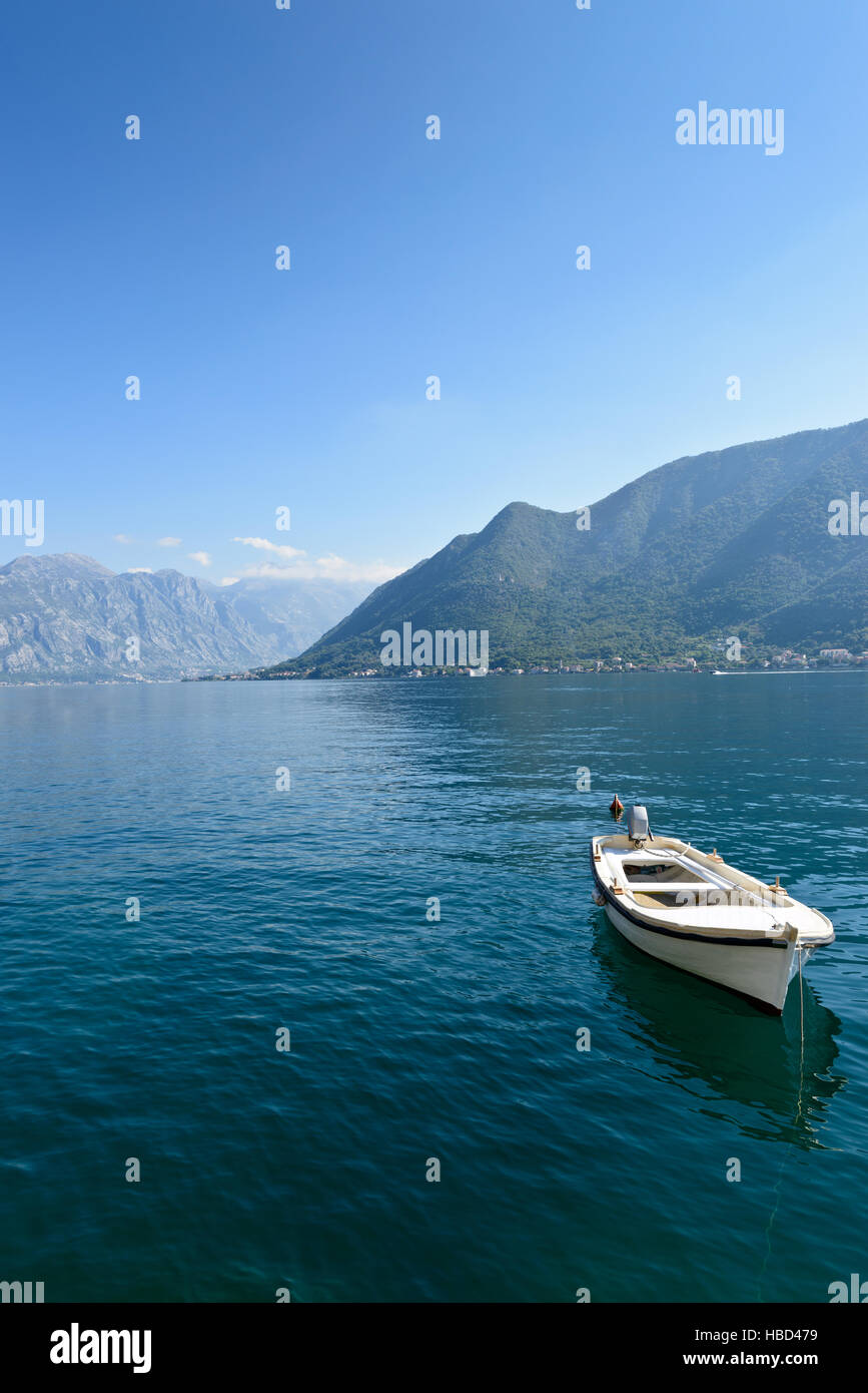 Single boat at smooth sea surface near Perast, Kotor Bay, Montenegro - Stock Image