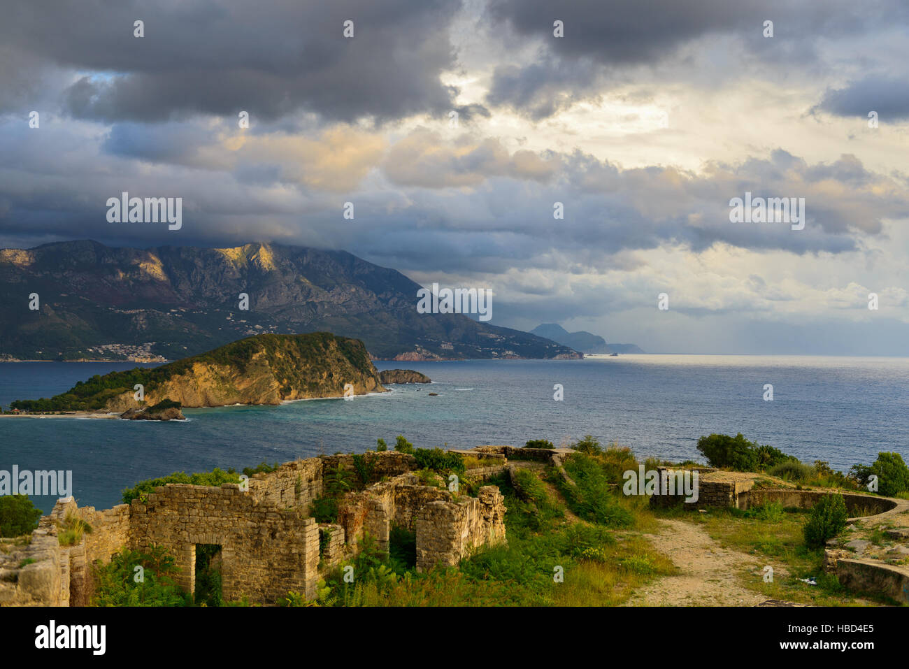 View to Budva bay from ruins of medieval fortress Tvrdava Mogren at the shore of Adriatic sea. Historic attractions - Stock Image