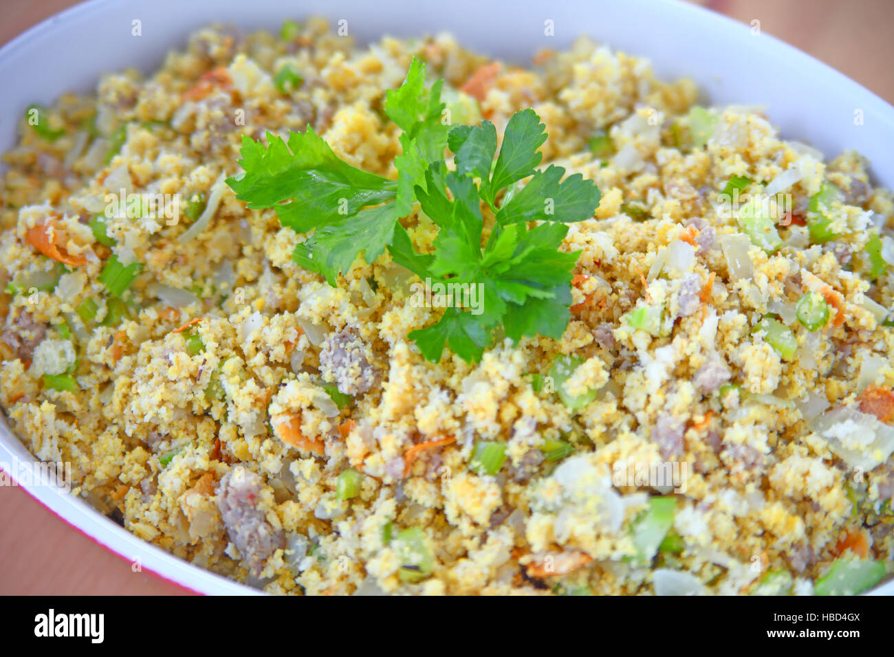 Traditional Thanksgiving side dish of crumbled cornbread, celery, onion and sausage - Stock Image