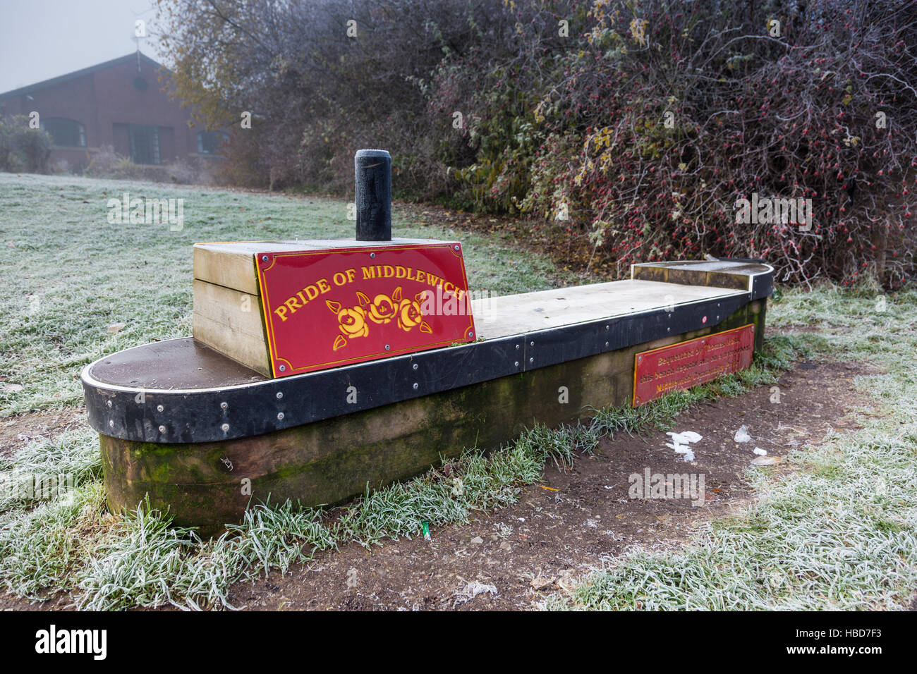 Canal bench on the side of the Trent & Mersey Canal, Middlewich, Cheshire - Stock Image