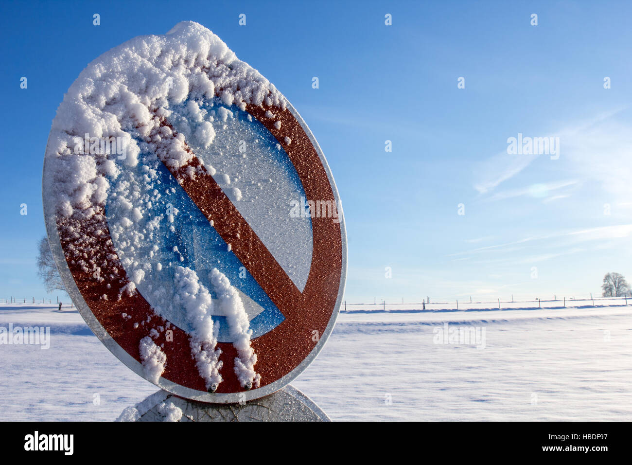 A snowed Stopping Sign, a closeup Stock Photo