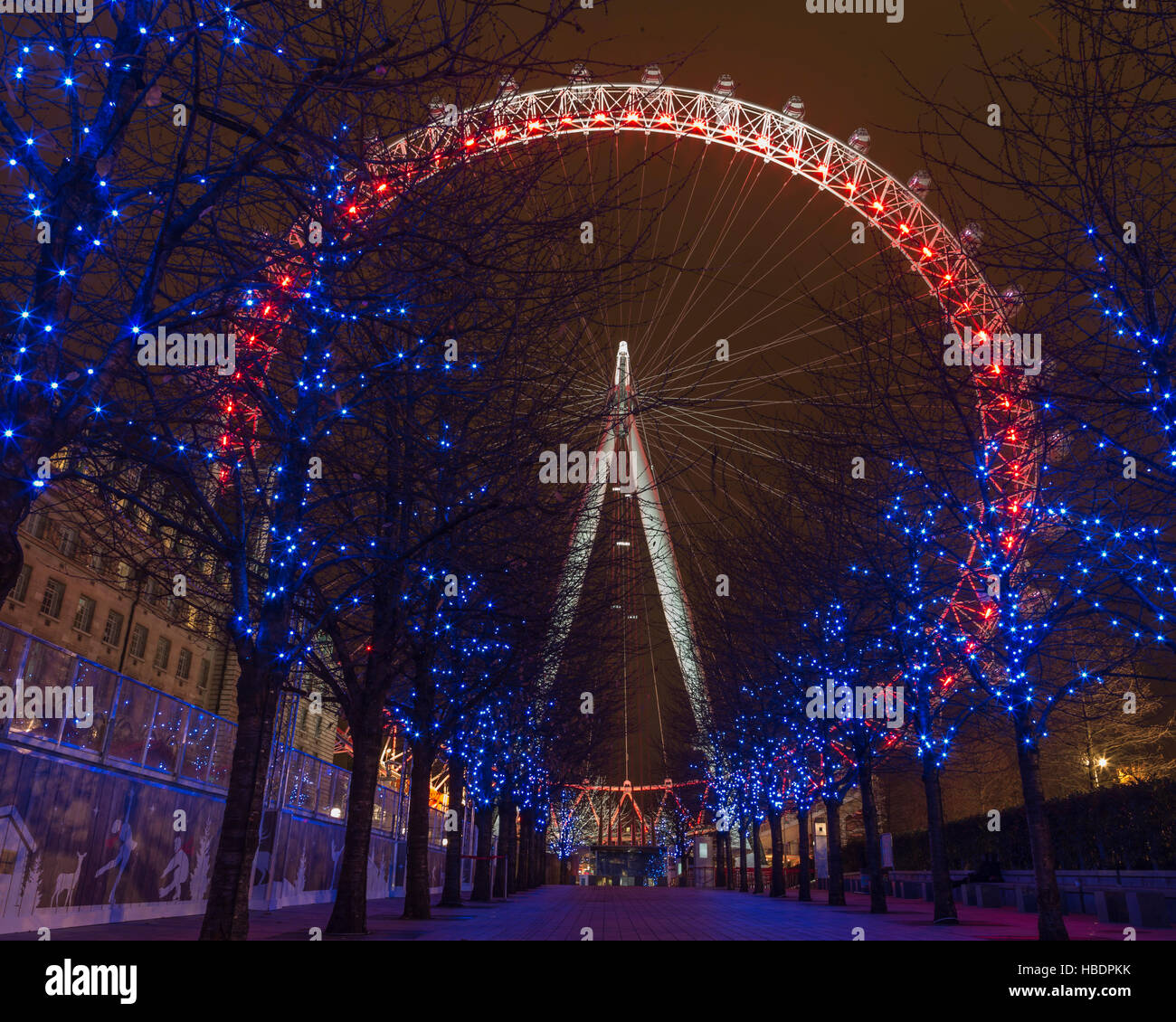 The London Eye looking positively festive. - Stock Image