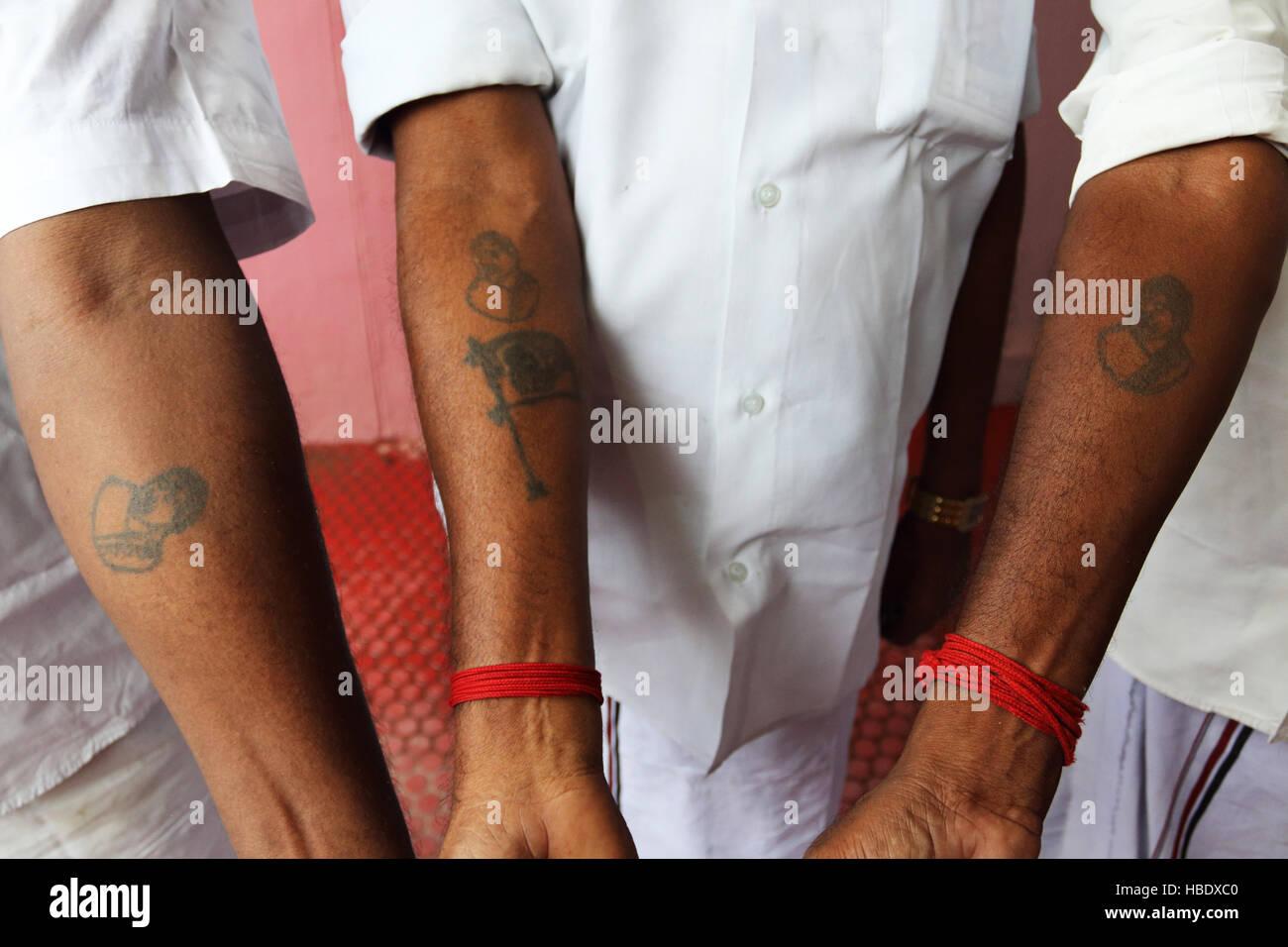 Devotees of Jayalalitha Jayaraman, former actress, state minister of Tamil Nadu, show off their Jayalalitha  tattoos. - Stock Image