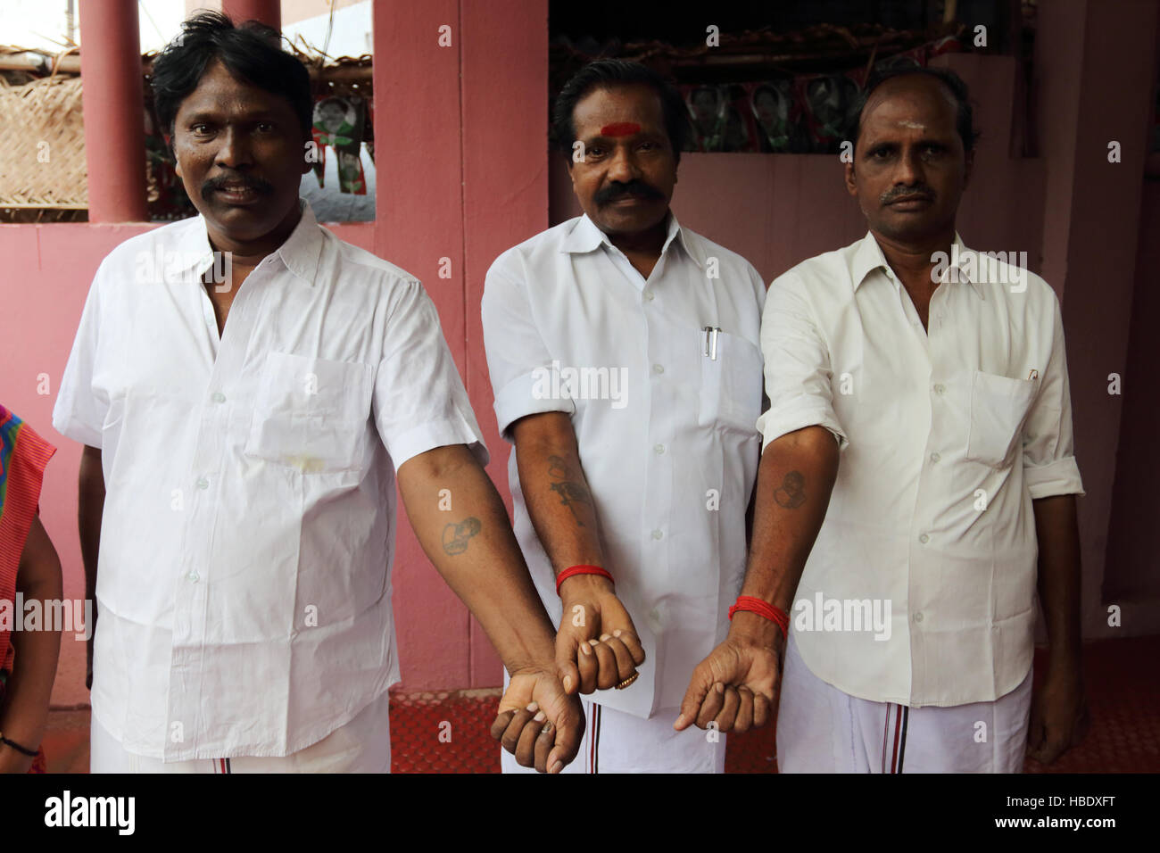 Devotees of Jayalalitha Jayaraman, former actress, state minister of Tamil Nadu, pose with tattoos of their political - Stock Image