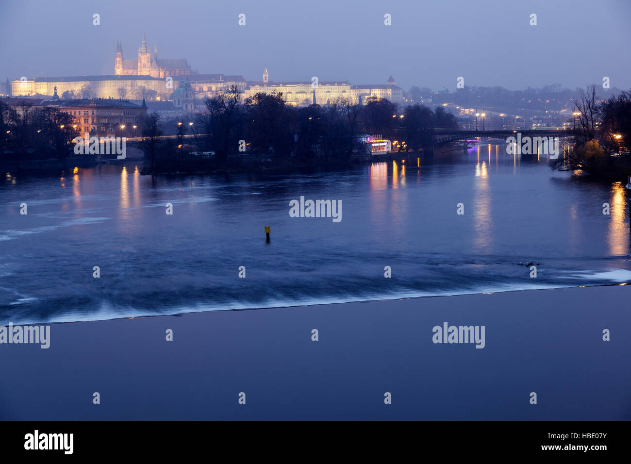 Misty blue hour view of the Castle over the Vlatva River, Prague, Czech Republic - Stock Image