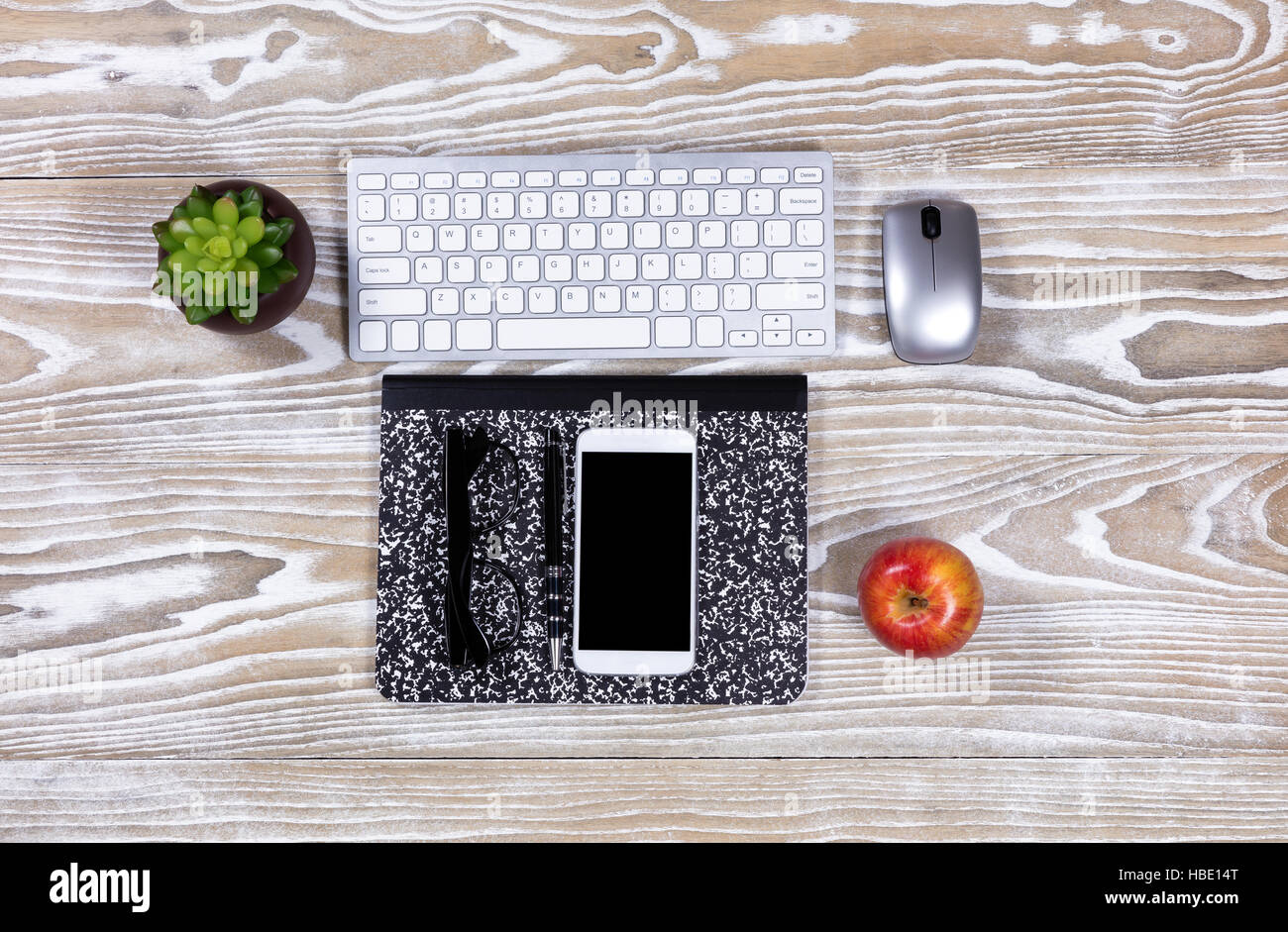 Fading desktop with stationery and technology - Stock Image
