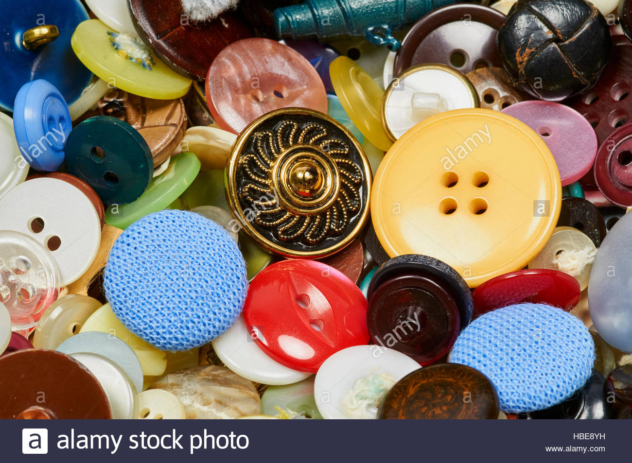 A selection of mixed buttons on a display stand - Stock Image
