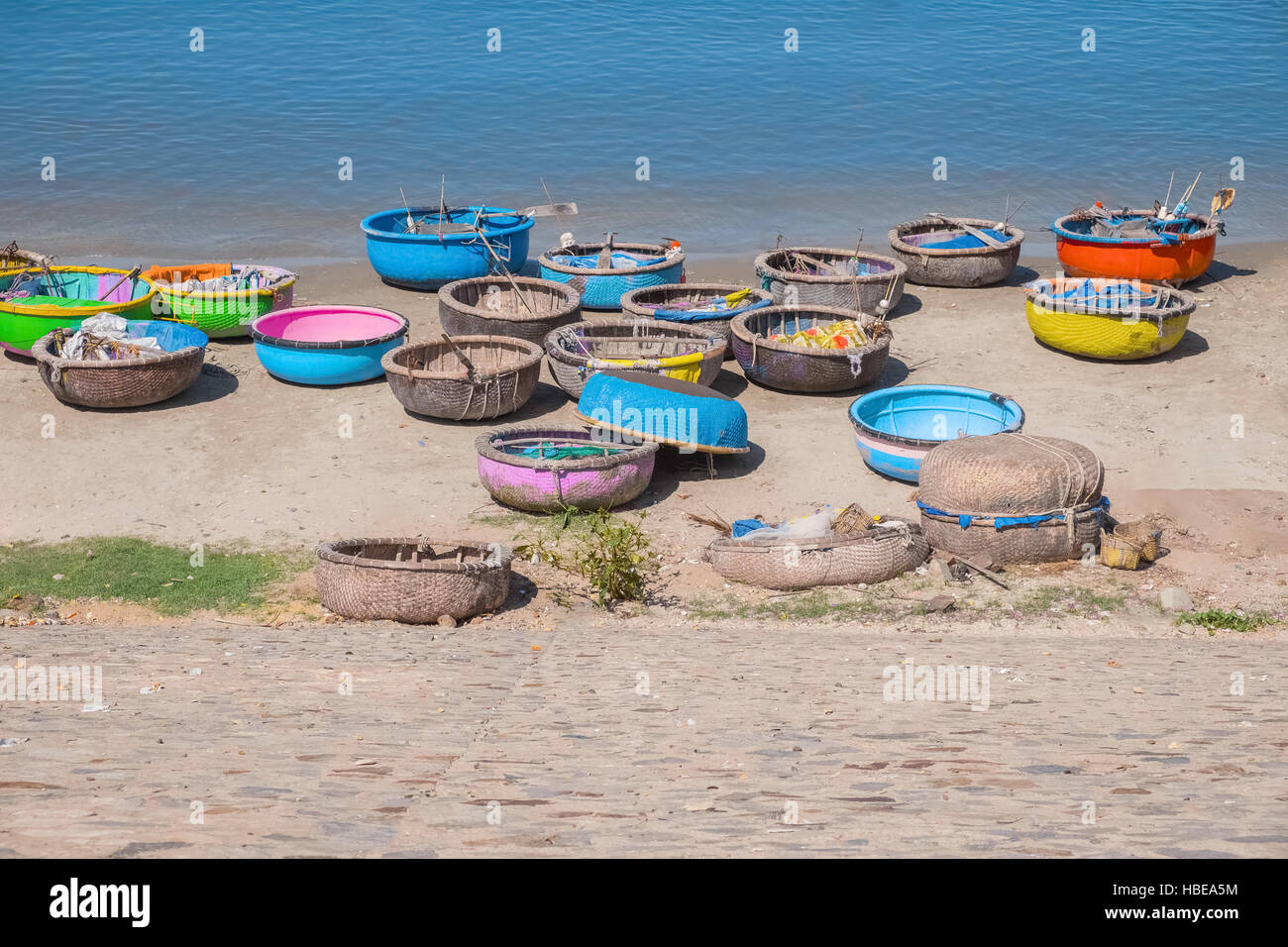 Colorful traditional boats in fishing village, Mui Ne Binh Thuan Province Vietnam Southeast Asia. Round basket boats, - Stock Image