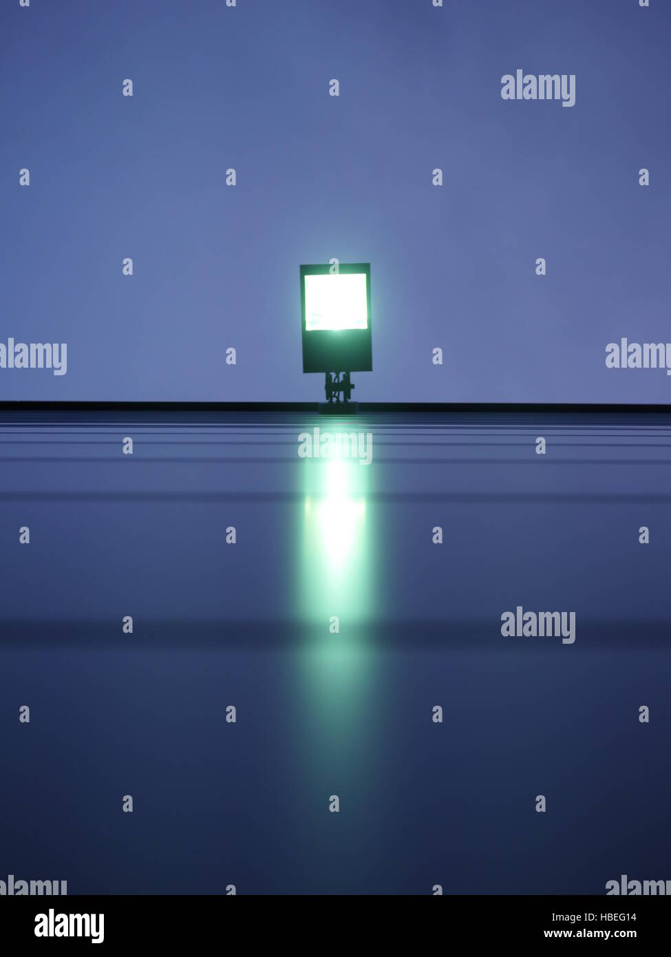 Floodlight with green light - Stock Image