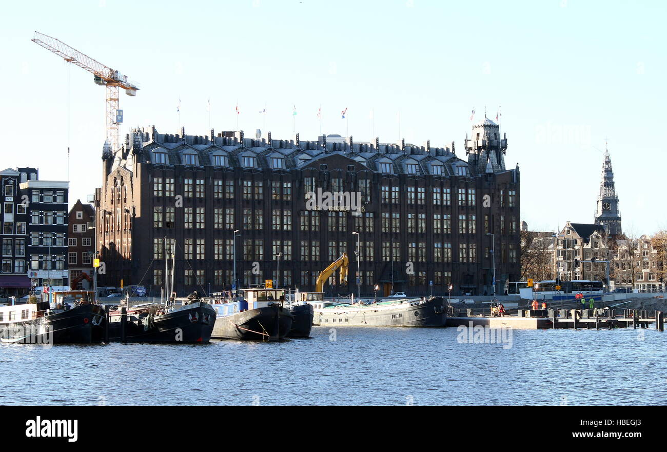 Scheepvaarthuis (Shipping House) at Prins Hendrikkade in Amsterdam, Netherlands. Built in the Amsterdam School style, - Stock Image