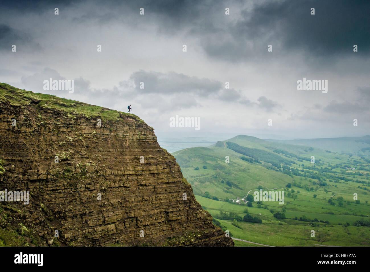 Walker on hill, Peak District, Derbyshire, UK. - Stock Image